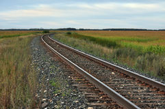 Railroad tracks on the prairie. Railroad tracks on a lonely prairie landscape Royalty Free Stock Images