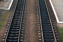 Railroad tracks with railroad switch two paths come together Royalty Free Stock Image