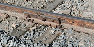 Railroad tracks and railroad ties on a rock bed royalty free stock photography