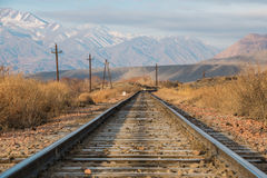 Railroad tracks. Railway tracks on a bed of rock Royalty Free Stock Photos