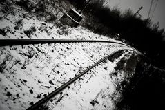 Railroad tracks or railway among snow in winter Stock Image