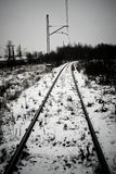 Railroad tracks or railway among snow in winter Stock Photography