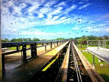 Railroad tracks through raindrop window Stock Photos