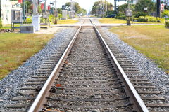Railroad tracks and road Stock Photo