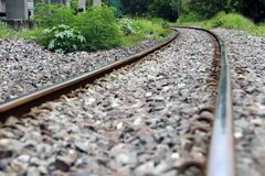 Railroad tracks and rocks in Thailand, metal railway of train. stock photo