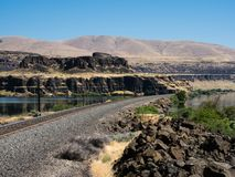 Railroad tracks running along Columbia River Gorge - WA, USA royalty free stock photo