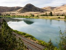 Railroad tracks running along Flathead river in Montana, USA royalty free stock photo
