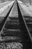Black and White Image of Railroad Tracks in the Mountains. Railroad tracks running through the mountains located in rural southwest Virginia, USA royalty free stock photo