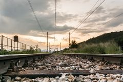 Railroad tracks running towards sunset Stock Images