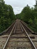 Railroad Tracks Running Through Woods Stock Photos