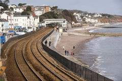 Railroad tracks on the seawall at Dawlish Devon England UK royalty free stock photo