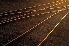 Railroad tracks shine at sunset in Kansas Stock Images