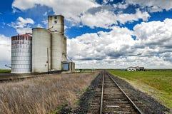 Railroad Tracks and Silos Royalty Free Stock Photos