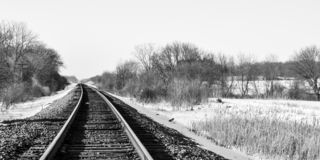 Railroad Tracks - Snow Covered Landscape stock photography