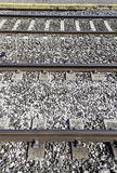 Railroad tracks at a station Stock Images