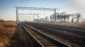 Railroad. Tracks stretching into the distance beyond the horizon Stock Images