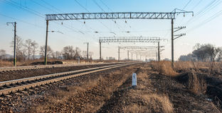 Railroad. Tracks stretching into the distance beyond the horizon Stock Photos