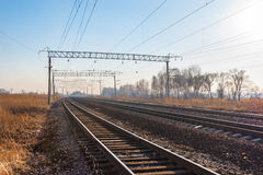 Railroad. Tracks stretching into the distance beyond the horizon Royalty Free Stock Photos