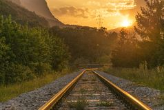 Railroad tracks at sunset Stock Image