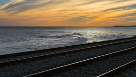 Railroad tracks at sunset Royalty Free Stock Photos