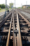 Railroad tracks and switches. Details of railroad tracks at a rail yard or junction with automated switches stock photo