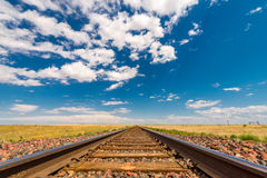 Railroad tracks to the horizon. Train tracks Photos taken just off Route 2 between Havre MT and Shelby MT stock images