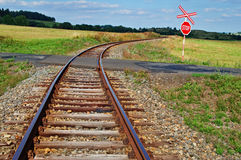 Railroad tracks to the railway crossing Royalty Free Stock Photos