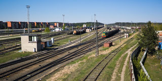 Railroad tracks and a train. Near a marshalling yard Stock Photos