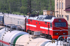Railroad tracks with train with cisterns and passenger train Stock Photo