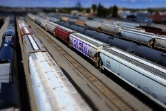 Railroad Tracks and Trains Cars in Miniature Mode Models Small T. Railroad tracks and train cars in miniature mode like models or small toys royalty free stock photo