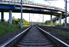 Railroad tracks under the automobile overpass.  Royalty Free Stock Image