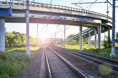 Railroad tracks under the automobile overpass.  Stock Photos