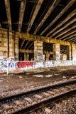 Railroad tracks under a bridge in Philadelphia, Pennsylvania. Stock Photography