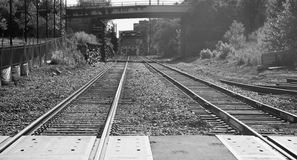 Railroad Tracks Under and then Over a Bridge Stock Photos