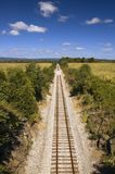 Railroad Tracks Vanish into Distance Royalty Free Stock Photography
