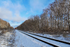 Railroad tracks winter day. Russia. Stock Images