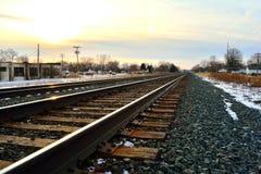 Railroad tracks on winter evening Stock Photos