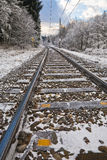 Railroad tracks in winter landscape - vertical. Railroad tracks in winter landscape at sunset leading to corner in background Stock Photo