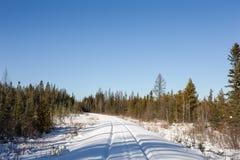 Railroad Tracks in Winter Snow Stock Photo
