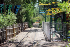 Railroad Tracks at the Zoo. Surrounded by fences and beautiful trees Stock Images