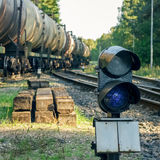 Railroad traffic light. And freight train on behind Stock Photography