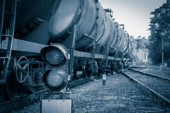 Railroad traffic light. And freight train on behind Royalty Free Stock Images