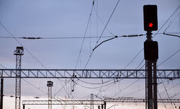 Railroad traffic light and overhead lines Royalty Free Stock Image