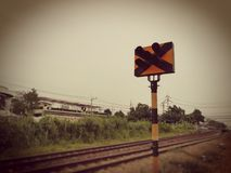 Railroad traffic pole. Picture in vintage and sepia tone. Railroad traffic pole. Picture with copy space in vintage and sepia tone Stock Photos