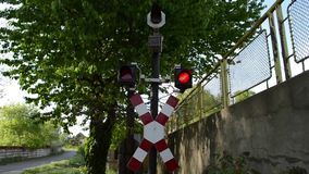 Railroad Train Alarm. Red Lights and sound alarm announce the train coming on a rail crossing stock video