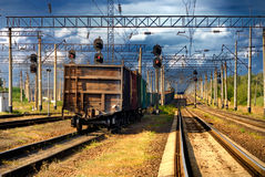 The railroad train with cars. Going into thunder-storm Royalty Free Stock Photo
