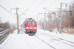 Railroad train is coming outside snowy weather Stock Image