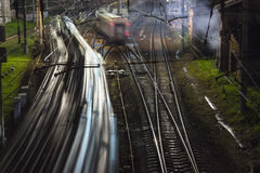 Railroad train fast motion. At night Royalty Free Stock Photography