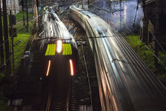 Railroad train fast motion. At night Stock Photos