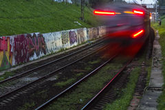 Railroad train fast motion. At night Royalty Free Stock Photo